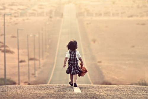 girl-walking-along-road