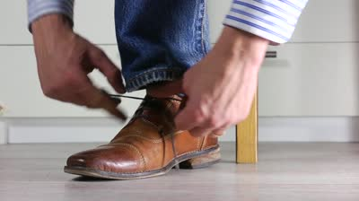 brown-leather-shoes-with-jeansman-ties-shoe-laces-stock-footage-video-27891---shutterstock-d3rhng6e